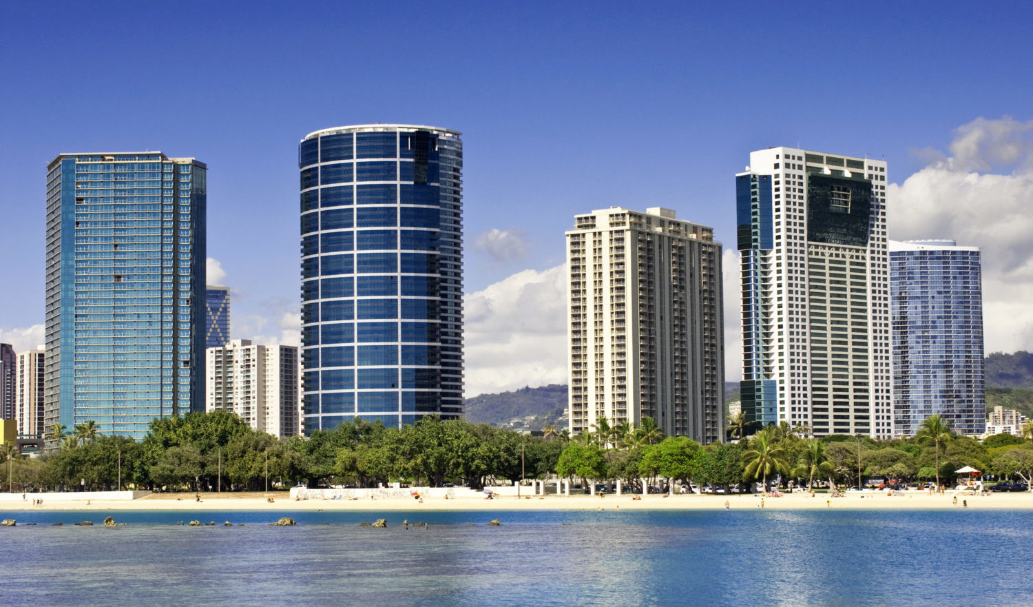 """Ala Moana Beach Park and luxury condominiums located near Waikiki. Honolulu, Oahu, Hawaii, USA."""