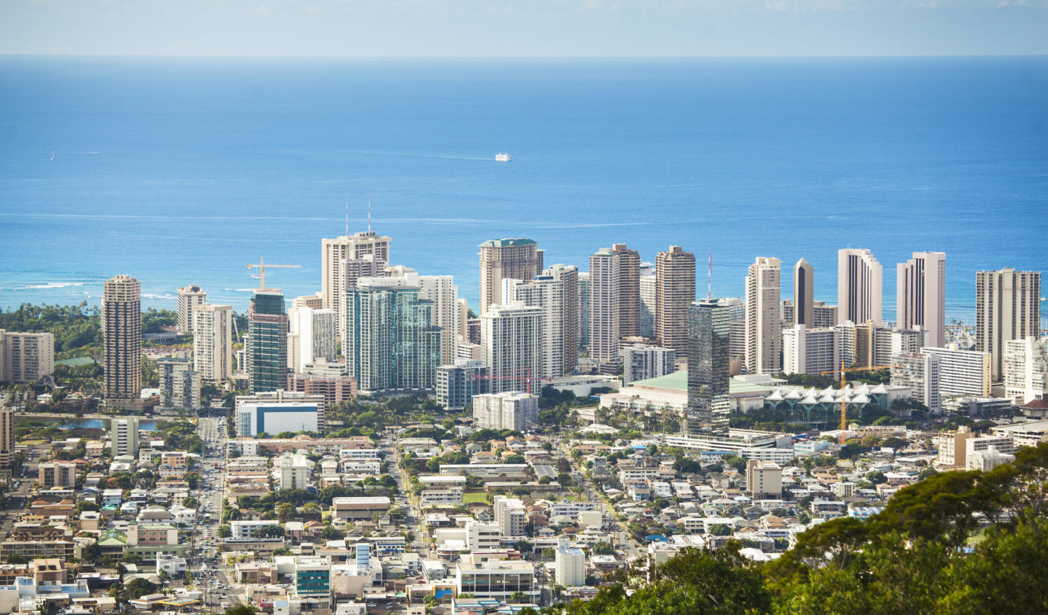 Honolulu, the capitol city of the state of Hawaii USA. The business district and downtown area skyline with the Pacific Ocean in background.