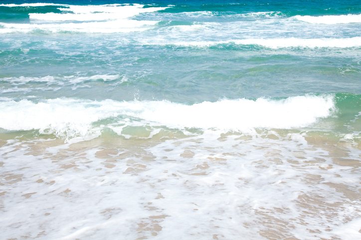 Waves and sandy beaches