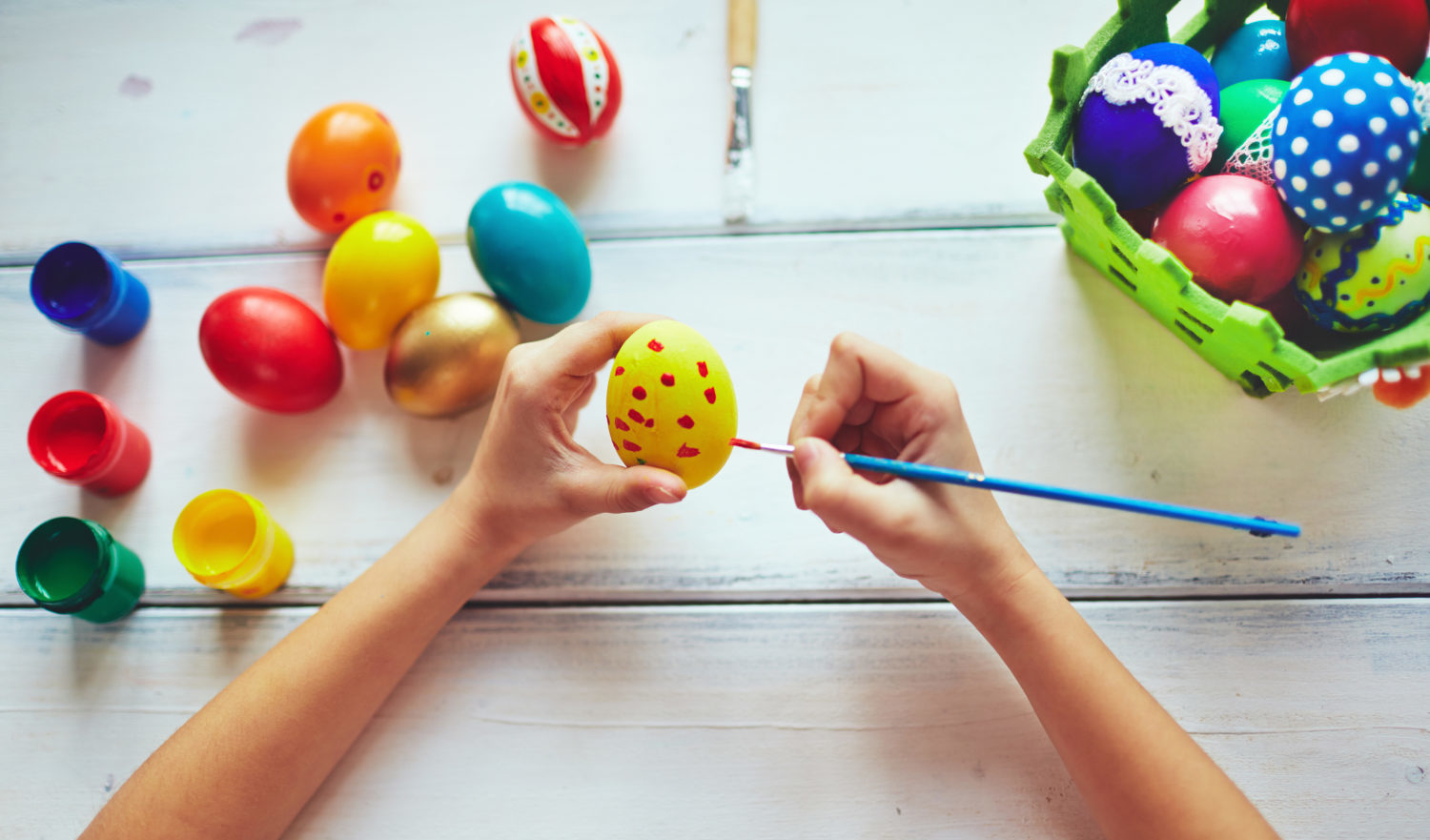 Girl decorating Easter eggs