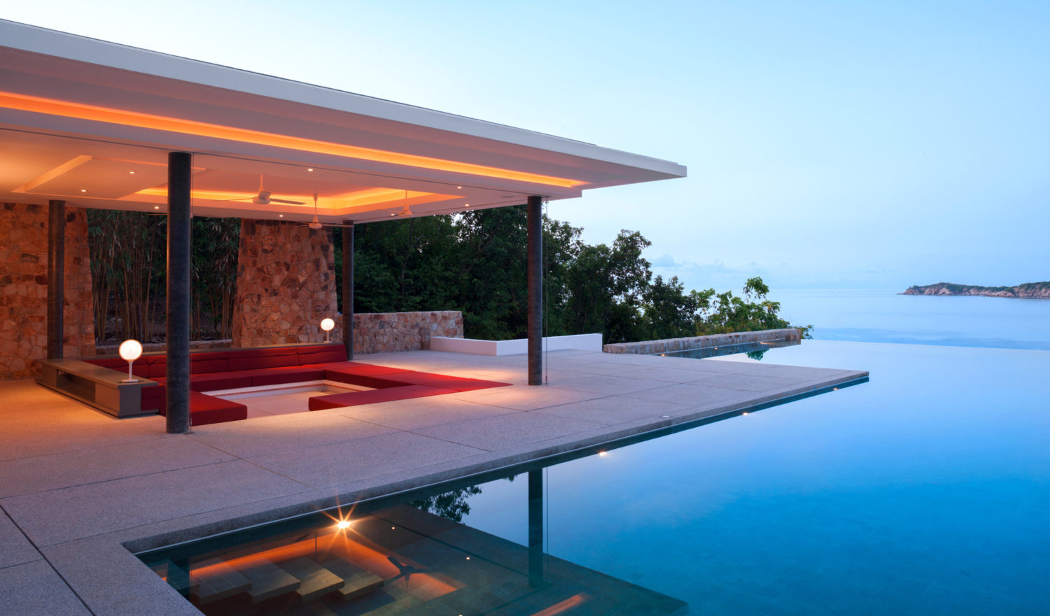 Luxury Island Home With Infinity Pool At Dusk.