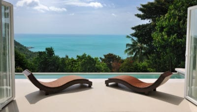 Brown chaise lounges at private pool villa