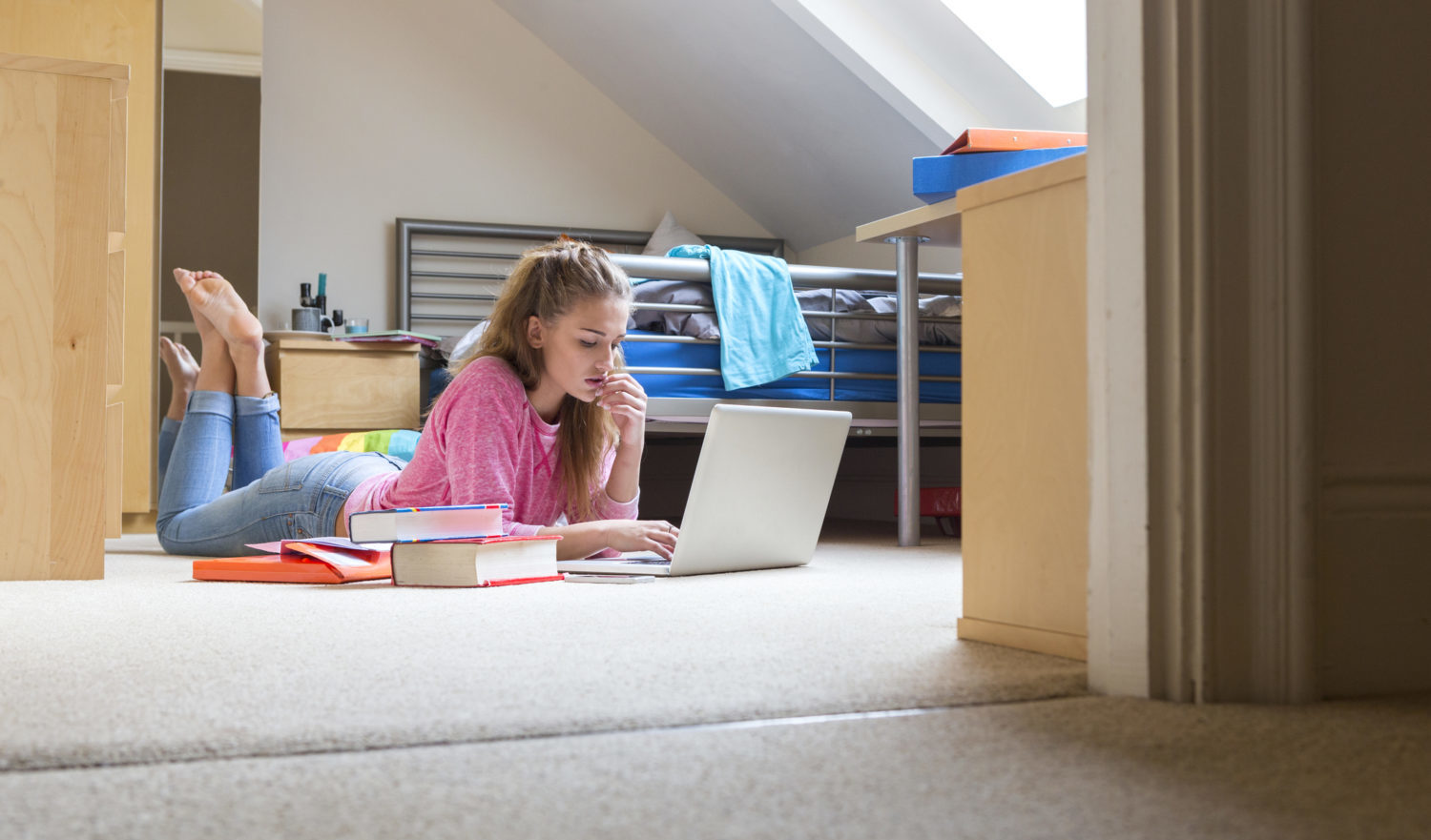 Young woman studying in student accommodation