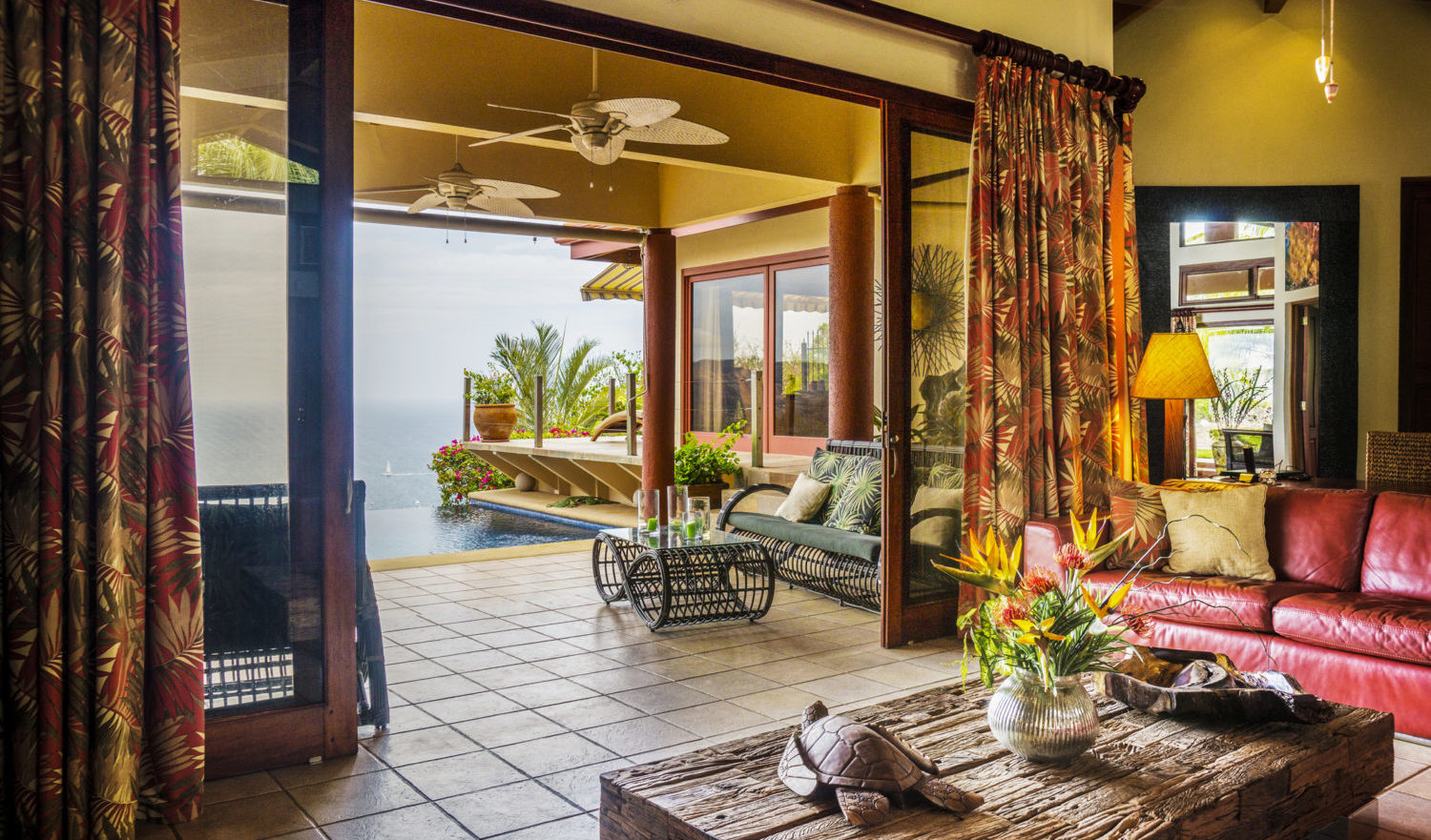 An interior view looking outwards to the ocean in a luxury villa in the tropics.  Located in Guanacaste, Costa Rica.