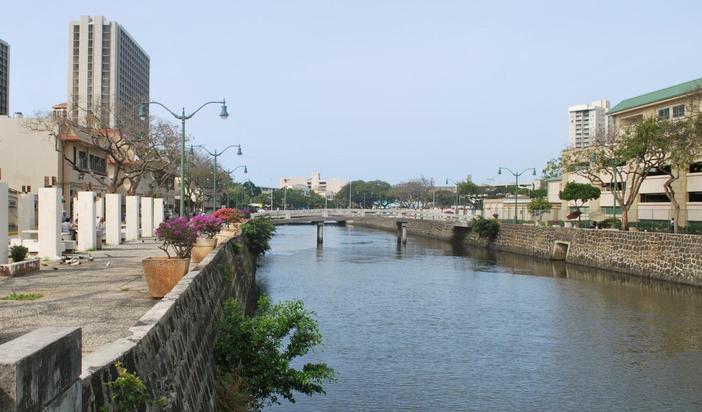 """""""River Street in Chinatown, Honolulu. View of Nu'uanu stream."""""""