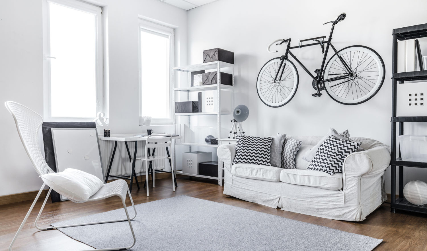 Black and white studio room of young hipster